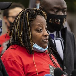 Clifftina Johnson cries as she talks about her daughter, Tafara Williams, during a press conference outside Waukegan's city hall complex, Tuesday morning, Oct. 27, 2020. Williams, 20, was wounded and her boyfriend, 19-year-old Marcellis Stinnette, was killed when they were both shot by a Waukegan police officer on Oct. 20.