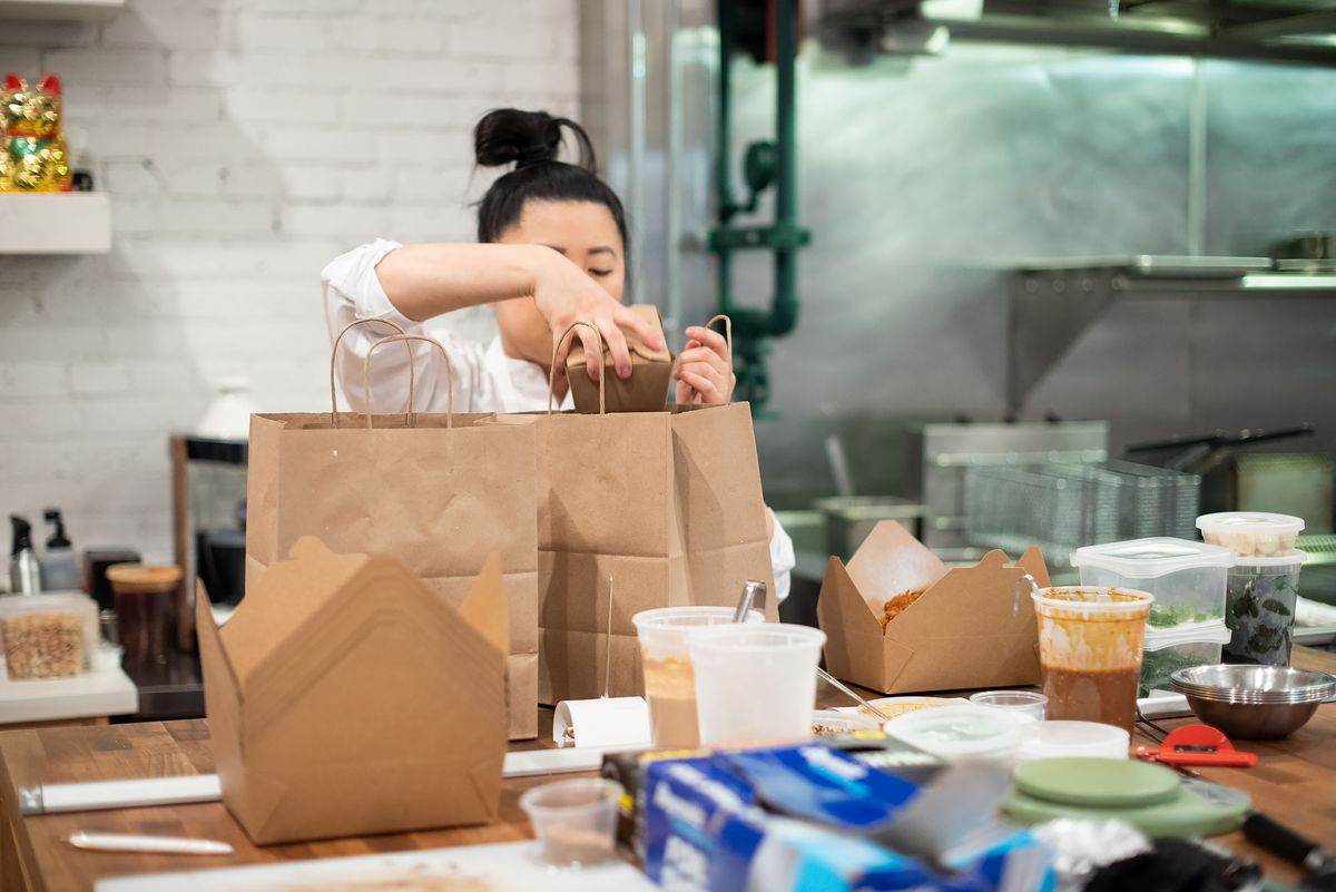 Mei Lin packs takeout orders at Nightshade,