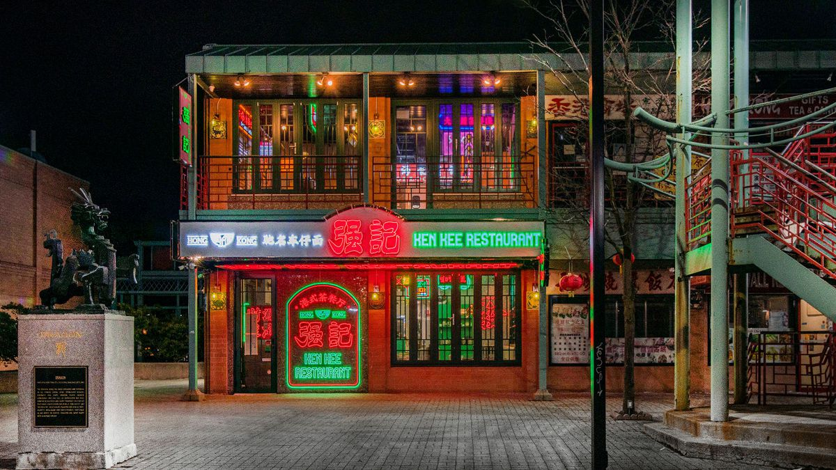 A neon-lit two-story restaurant.