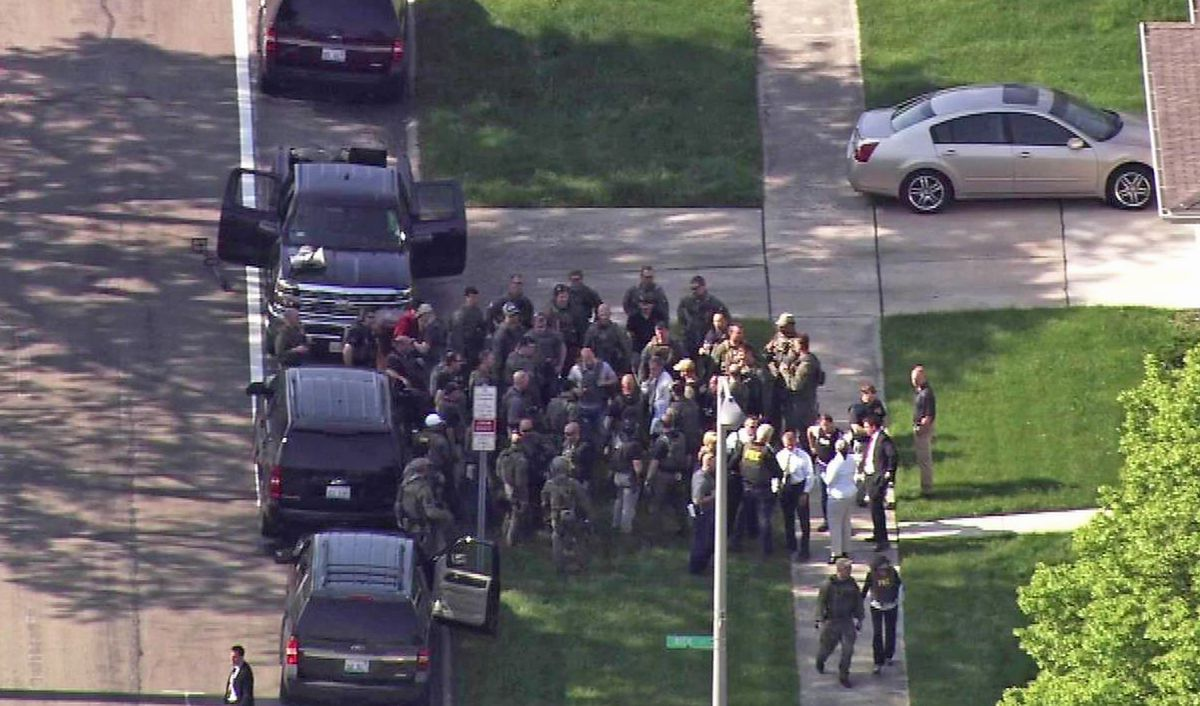 Law enforcement converged on a Park Forest home Tuesday morning to serve an arrest warrant. Two FBI agents were shot and the man they were seeking was found dead inside. Nearby schools were delayed. | Courtesy ABC7-Chicago