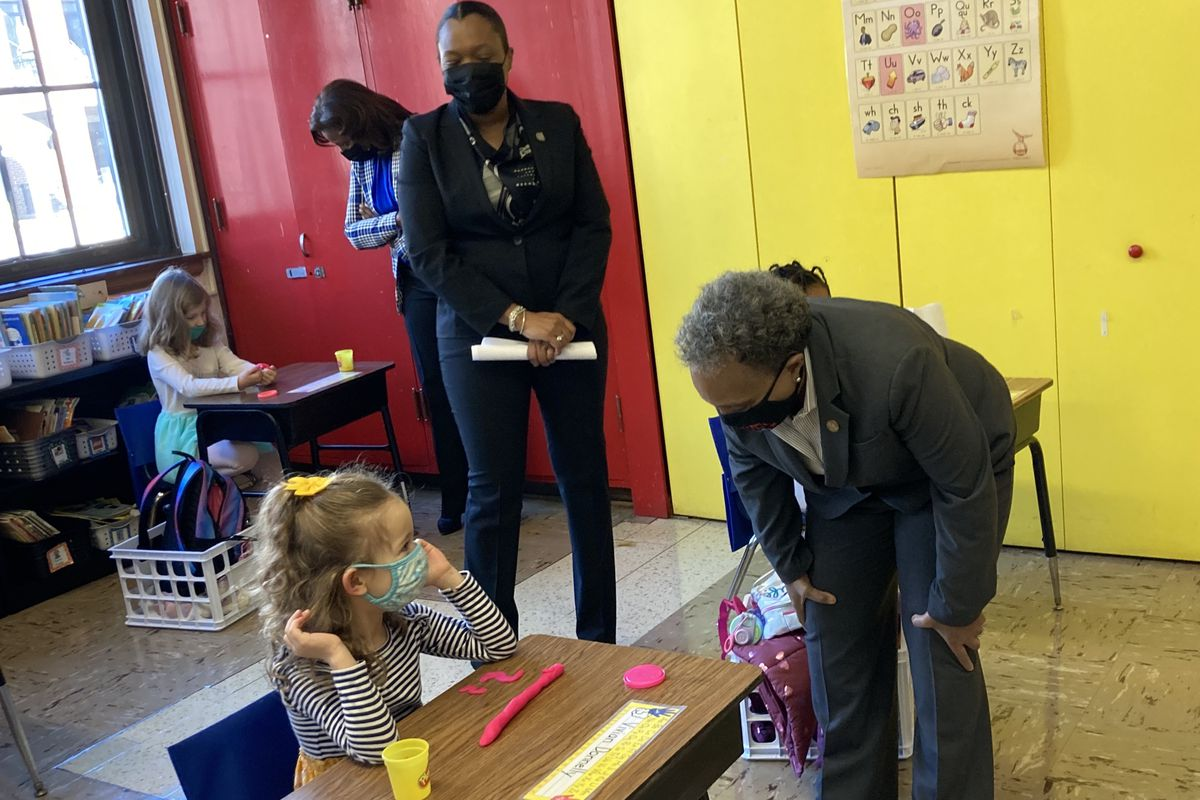 Mayor Lori Lightfoot greets a Chicago student on March 1, 2021.