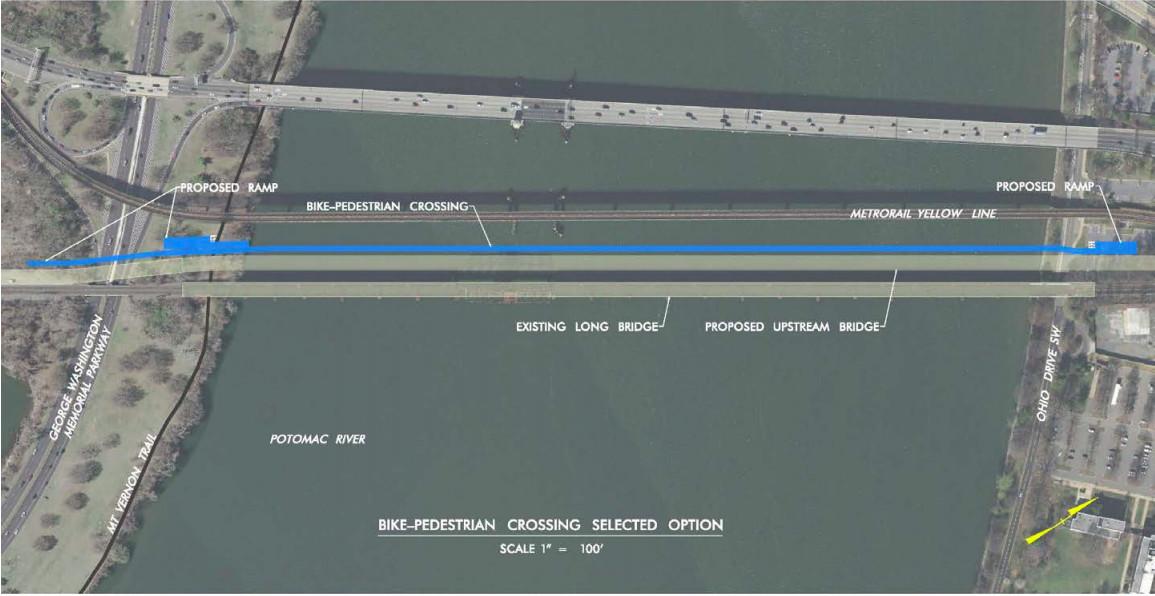 An aerial photo of a bridge redevelopment project, showing a river, bridges, and adjacent landmass.