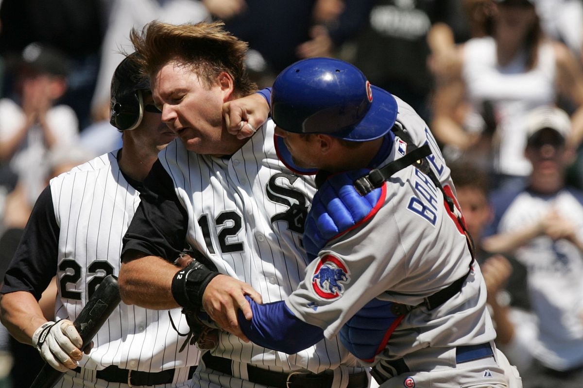 Chicago Cubs' Michael Barrett, right, punches Chicago White