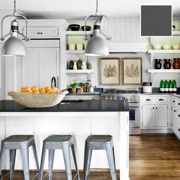 Quartz kitchen countertop in farmhouse themed room.