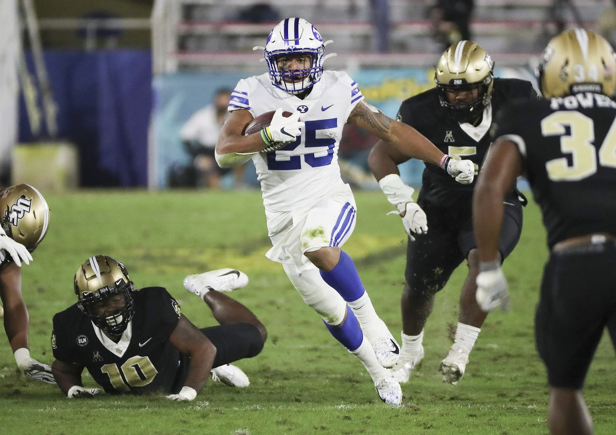 BYU running back Tyler Allgeier runs for a large gain against the UCF Knights during the Boca Raton Bowl.