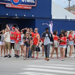 11:41 a.m. Blackhawks fans in front of the Cubs Store -