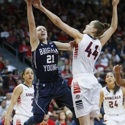Brigham Young Cougars guard Lexi Eaton (21) has her shot blocked by Gonzaga Bulldogs center Shelby Cheslek (44) during the West Coast Conference championship game in Las Vegas Tuesday, March 11, 2014. BYU lost 71-57.
