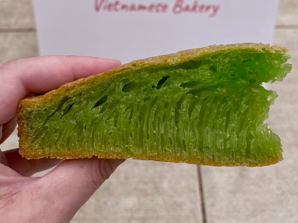 Green slice of cake with a honeycomb-like interior at Belu