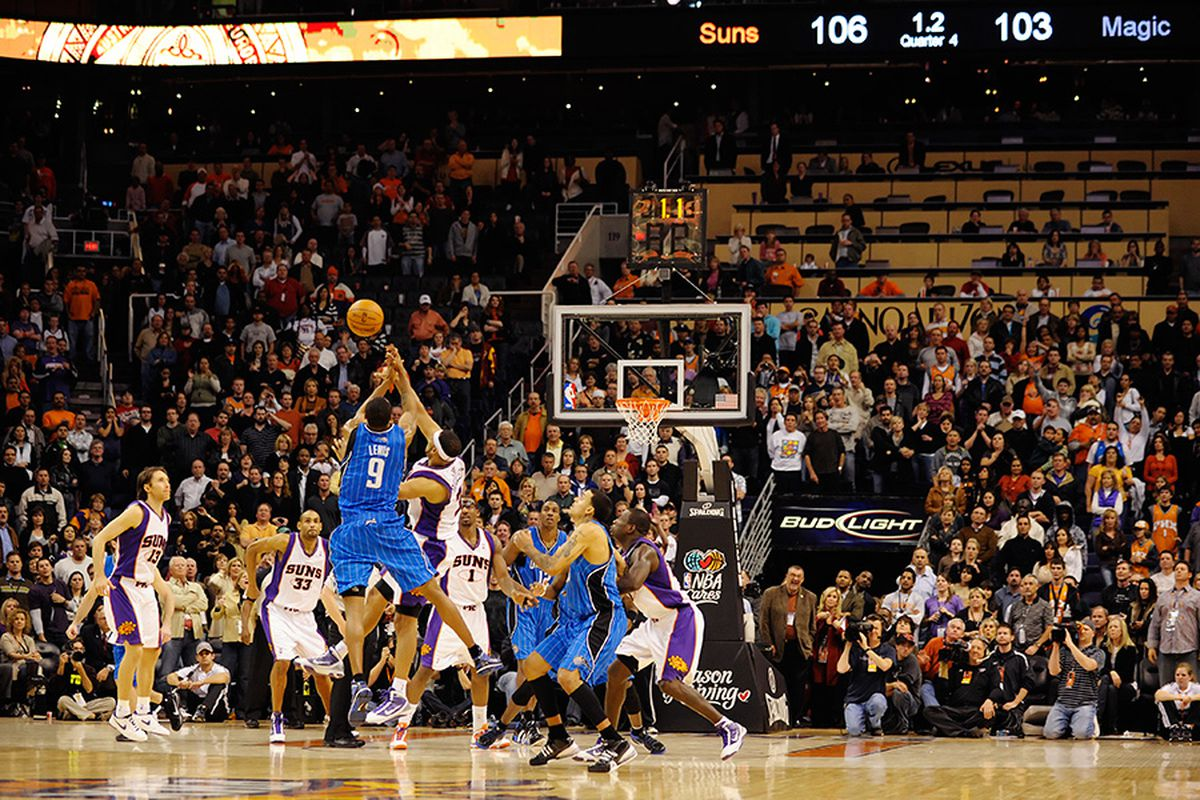 The Suns vs Magic game end on this jumpball after Amare tied up Pietrus after a missed three by Rashard Lewis. (Photo by Max Simbron)