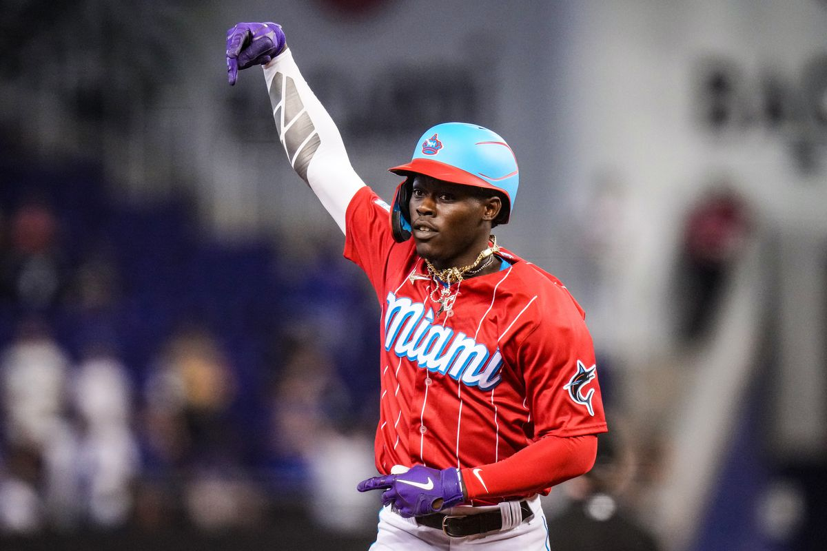 Jazz Chisholm Jr. #2 of the Miami Marlins hold up the peace sign while running the bases after hitting a solo homerun in the sixth inning against the Chicago Cubs at loanDepot park