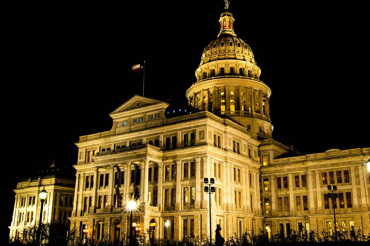 Texas Capitol building at night, lit up, from below