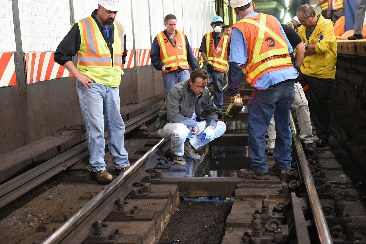 Governor Andrew Cuomo examines track debris at Union Square, Sept. 6, 2017.