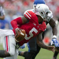Ohio State Buckeyes quarterback Braxton Miller (5) tries to evade pressure from Buffalo Bulls linebacker Khalil Mack (46) at Ohio Stadium. Ohio State won the game 40