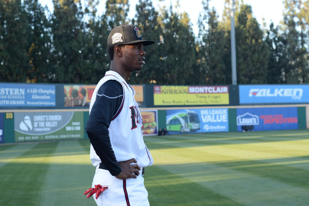 Raimel Tapia warms up in the outfield prior to the All-Star game.