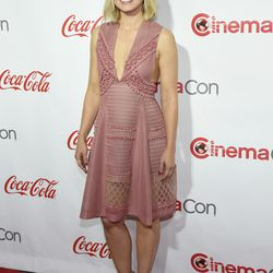 Kristen Bell, in a Burberry dress and Christian Louboutin shoes.