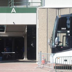 11:07 a.m. Gate A clear of employees checking in, next to the visiting team bus -