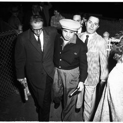 """In a spiffy cardigan for a murder trial in 1958. Photo via the <a href=""""http://digitallibrary.usc.edu/"""">USC Digital Library</a>."""