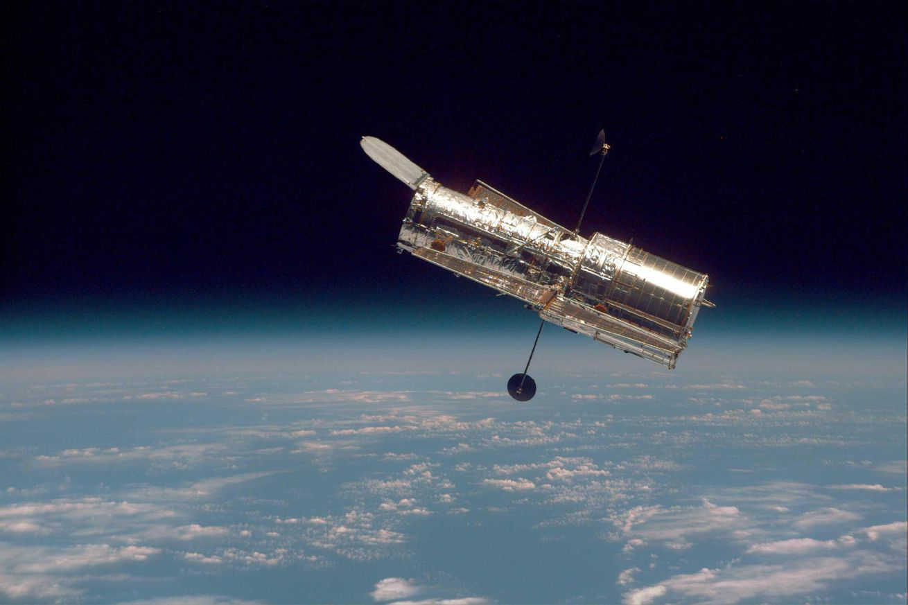 <em>NASA's Hubble Space Telescope, as seen from Space Shuttle Discovery</em>
