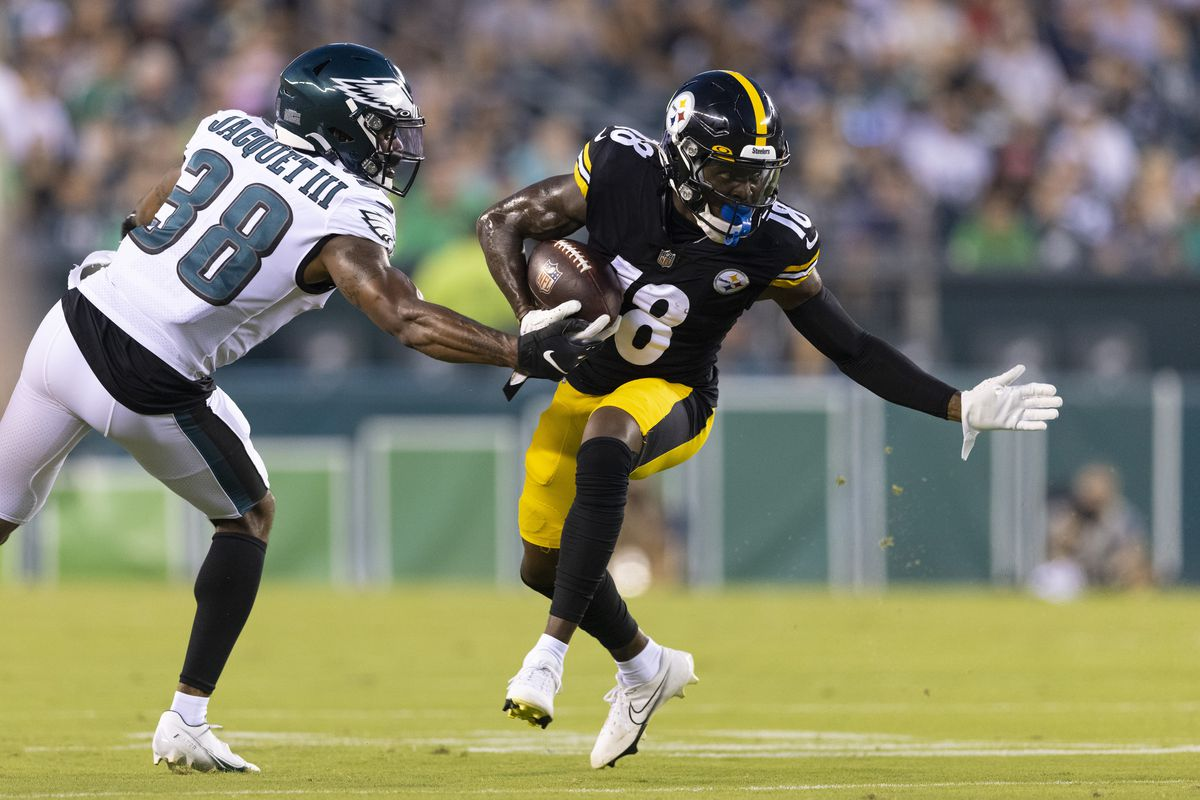 Diontae Johnson #18 of the Pittsburgh Steelers runs with the ball against Michael Jacquet #38 of the Philadelphia Eagles in the first quarter of the preseason game at Lincoln Financial Field on August 12, 2021 in Philadelphia, Pennsylvania.