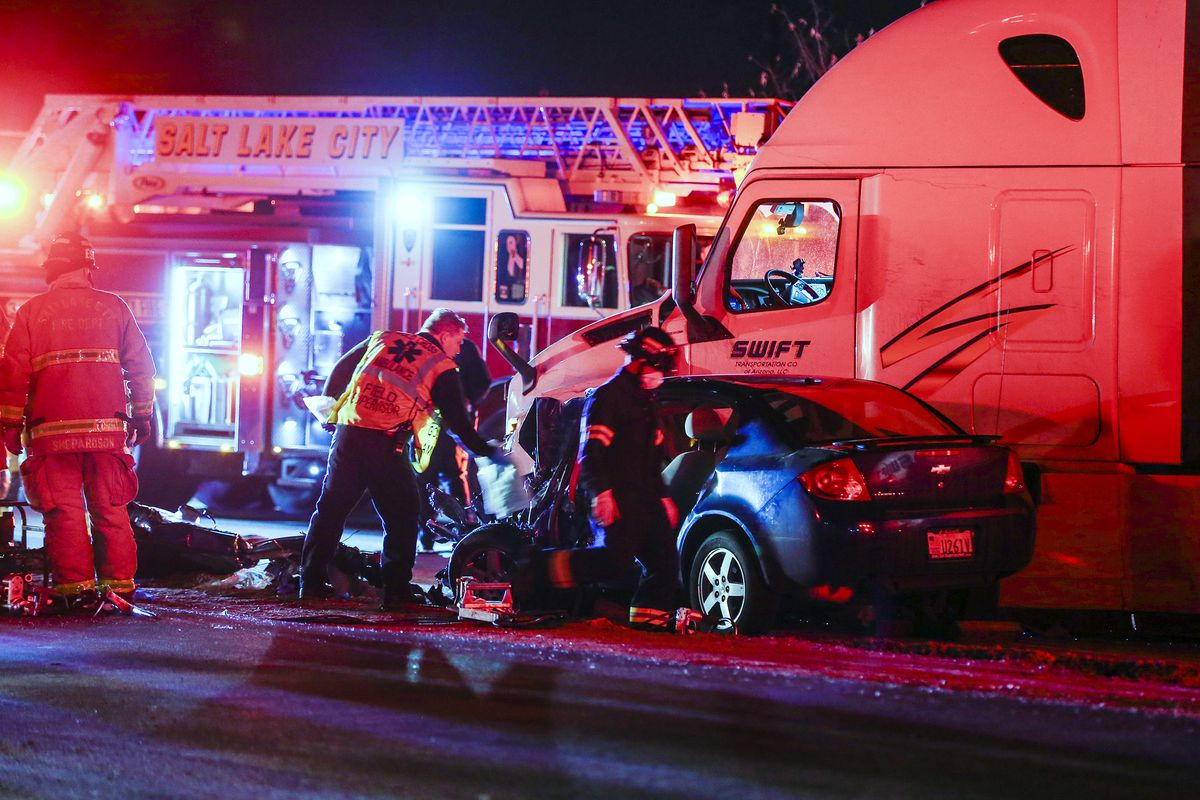 Emergency personnel investigate a fatal accident on 5600 West between 200 South and 300 South in Salt Lake City on Wednesday, Dec. 16, 2020.