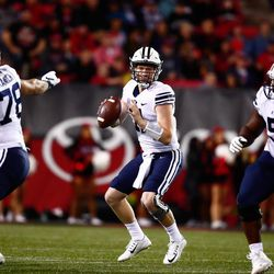 BYU quarterback Joe Critchlow looks to pass during the Cougars' 31-21 win over UNLV on Friday, Nov. 10, 2017, at Sam Boyd Stadium in Las Vegas.