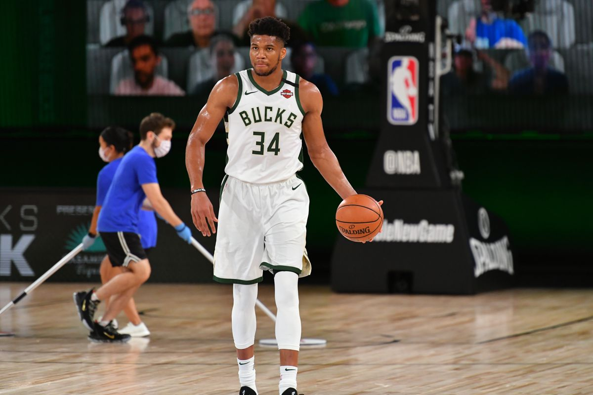 Giannis Antetokounmpo of the Milwaukee Bucks handles the ball during the game against the New Orleans Pelicans during a scrimmage on July 27, 2020 at The Arena at ESPN Wide World of Sports in Orlando, Florida.