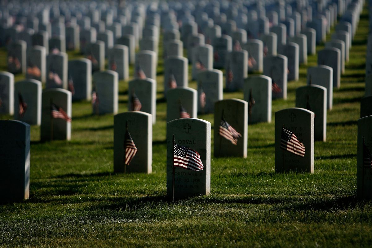 Small flags are placed in front of the graves at Arlington Cemetery for Memorial Day.