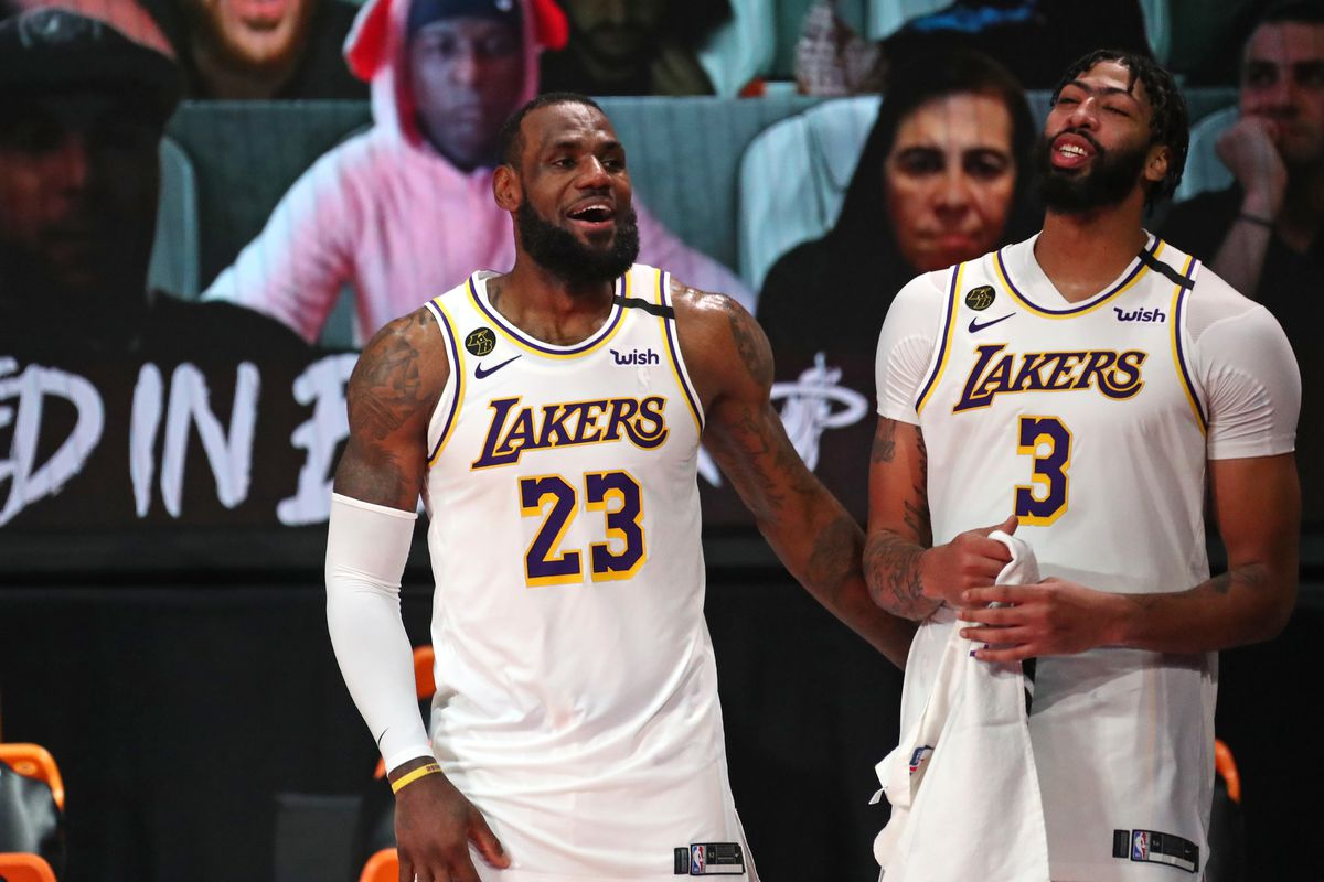LeBron James and Anthony Davis of the Los Angeles Lakers share a smile during Game Six of the NBA Finals on October 11, 2020 at AdventHealth Arena in Orlando, Florida.