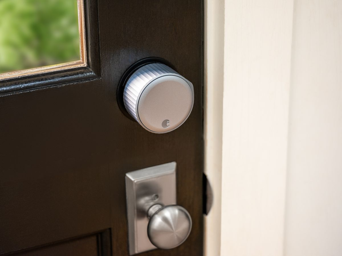August Wi-Fi Smart Lock installed on a brown door