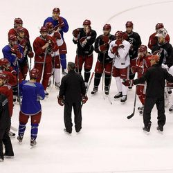 Phoenix Coyotes' Dave Tippett, middle, talks to all his players during practice on Wednesday, April 11, 2012, in Glendale, Ariz.  The Coyotes and the Chicago Blackhawks are scheduled to play Game 1 of an NHL hockey Western Conference quarterfinal series on Thursday.