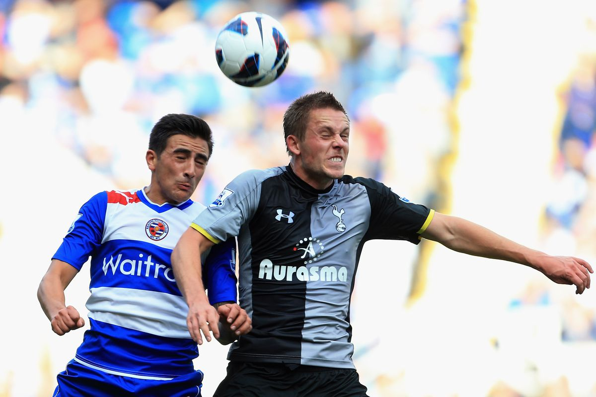 Karacan goes for the ball against former Royal Gylfi Sigurdsson in 2012