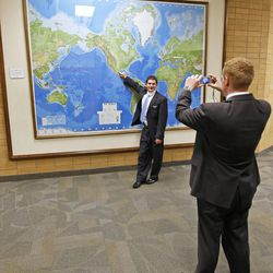 FILE - Elder Andrew Gilan, right, and Elder Tyler Swensen, left, take a picture of in front of a large map of the world in a hallway at the Missionary Training Center in Provo, Utah Thursday January 31, 2008. Gilan and Swensen were called to serve their two-year missions in Russia.