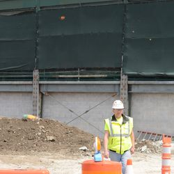 12:55 p.m. Wall now in place along this section of the west side of the ballpark -