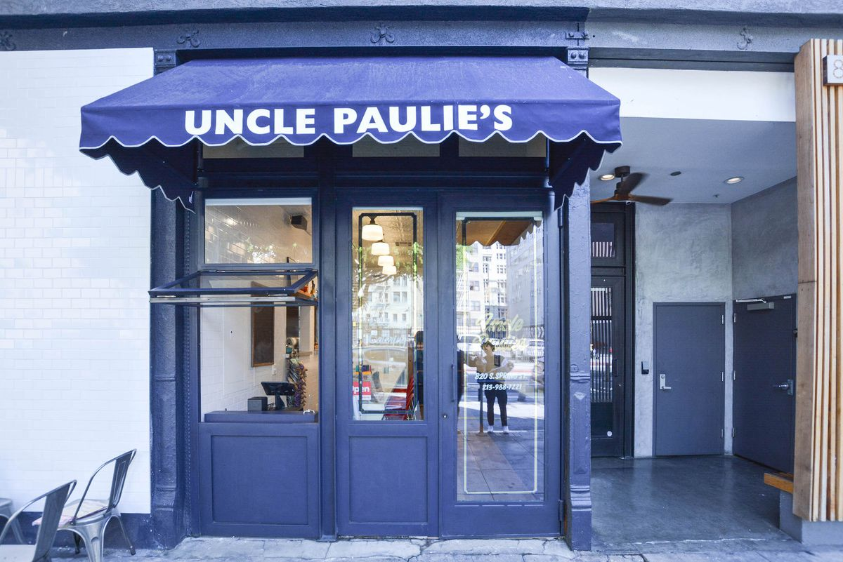A deep blue awning for a restaurant, with a takeout window.