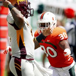 Miami defensive back A.J. Highsmith (30) rushes Bethune-Cookman quarterback Jackie Wilson in the first half of an NCAA college football game, Saturday Sept. 15, 2012, in Miami.