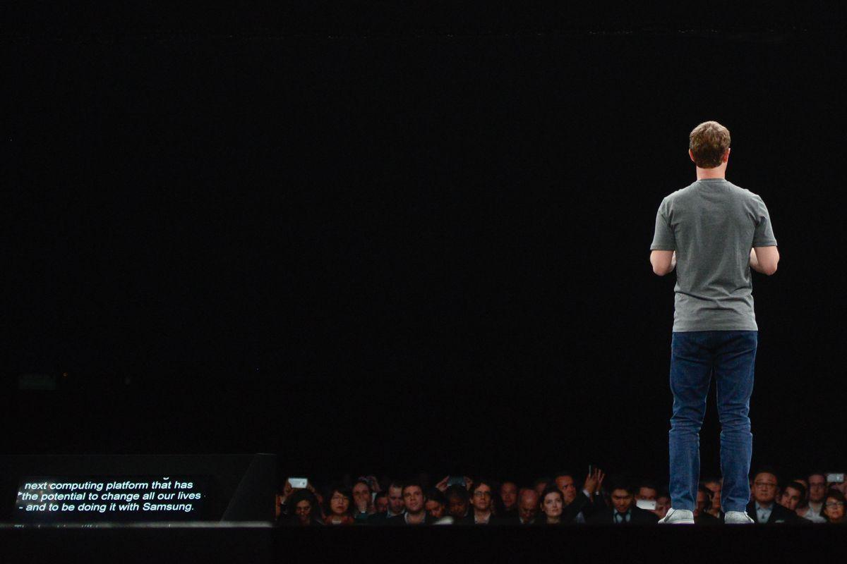 Facebook CEO Mark Zuckerberg onstage facing the audience
