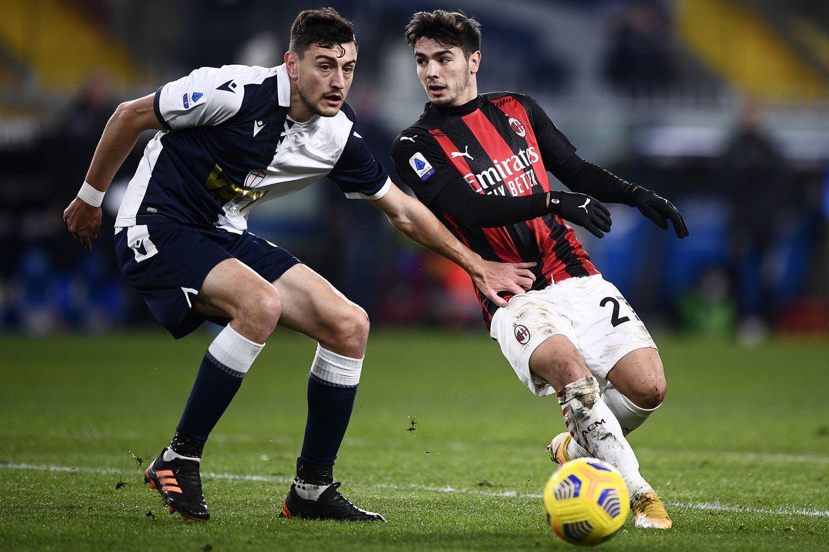 Brahim Diaz (R) of AC Milan is challenged by Alex Ferrari of...