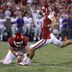 Oklahoma's Michael Hunnicutt (18) kicks a field goal against Kansas State in the second quarter of an NCAA college football game in Norman, Okla., Saturday, Sept. 22, 2012.
