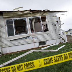 Police tape surrounds a destroyed house after a tornado struck Washington Terrace on Thursday, Sept. 22, 2016. Officials said nobody was injured in the twister.