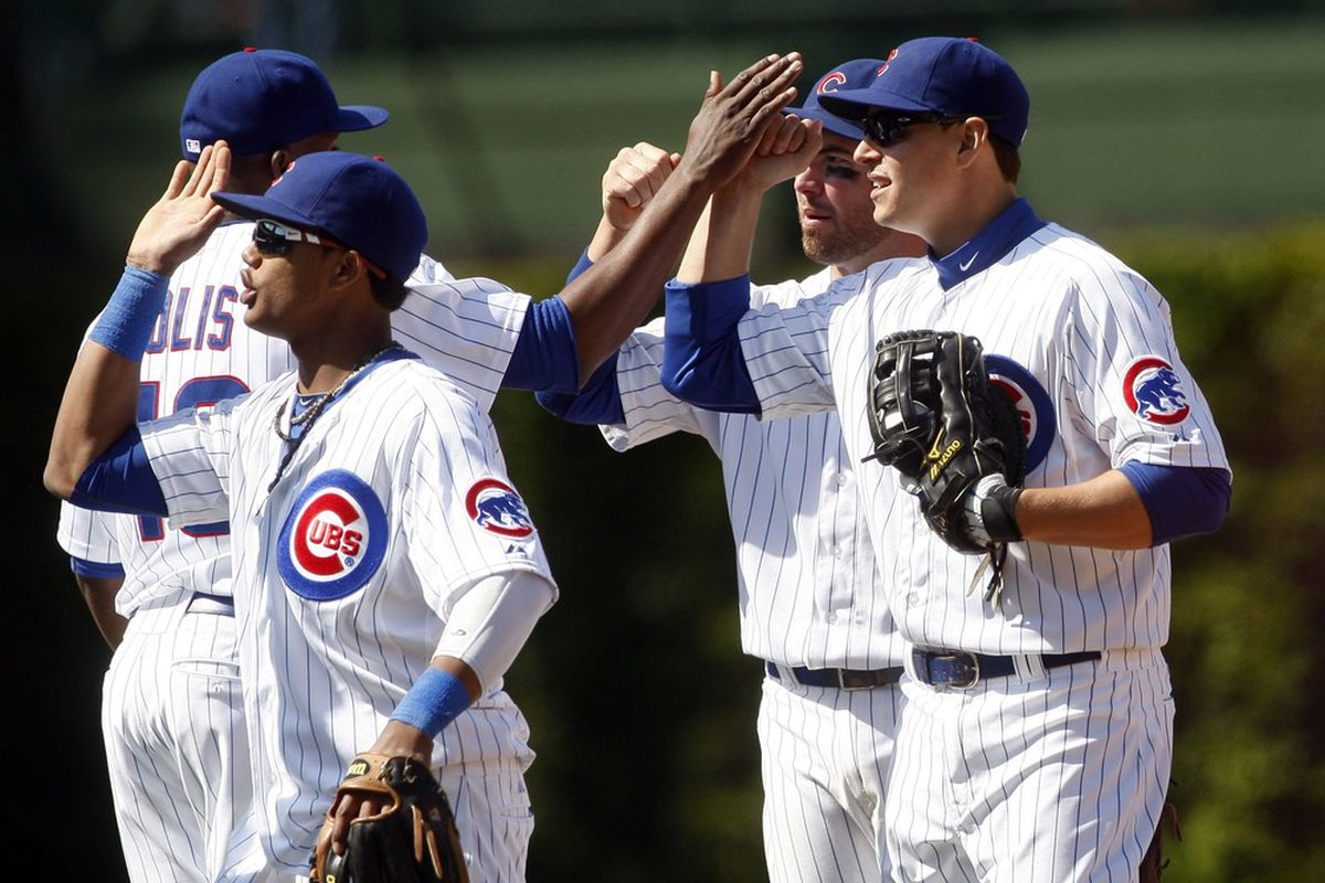 Chicago, IL, USA; Chicago Cubs players including Bryan LaHair celebrate after defeating the Atlanta Braves 1-0 at Wrigley Field. Credit: Jerry Lai-US PRESSWIRE