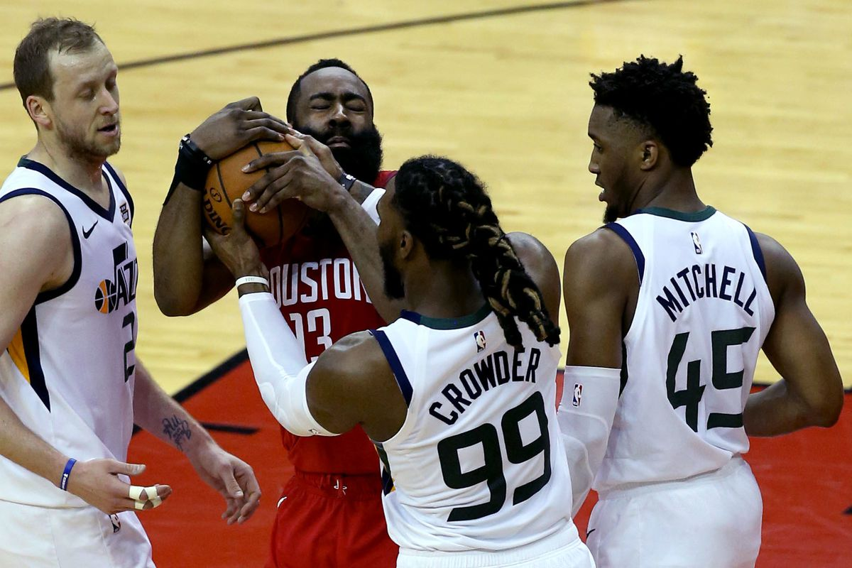 Houston Rockets guard James Harden (13) and Utah Jazz forward Jae Crowder (99) scuffle over the ball during Game 5 of a first-round NBA basketball playoff series in Houston on Wednesday, April 24, 2019.