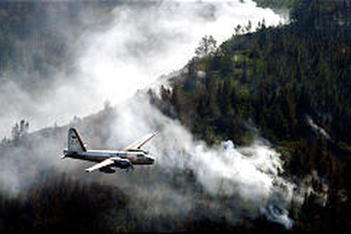 An air tanker prepares to drop a load of fire retardant Saturday on a smoldering area of the San Bernardino National Forest.