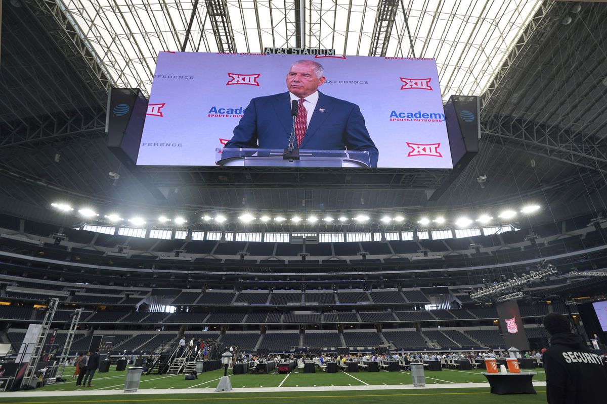 Big 12 commissioner Bob Bowlsby is shown on the giant screen as he speaks during Big 12 media days earlier this month. Bowlsby accused ESPN of trying to entice Big 12 schools to leave the conference.