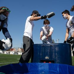Students throw ice into a wading pool for their version of the Polar Plunge at St. Patrick's High School.