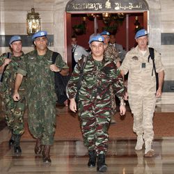 U.N. observers, led by Moroccan Col. Ahmed Himmiche, center, leave the Sheraton Hotel in Damascus, Syria, Monday, April 16, 2012.
