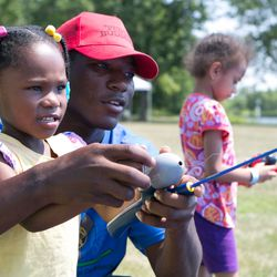Children learn to fish during the Forest Preserves' annual Kids' Fest event at Wampum Lake in south Cook County.
