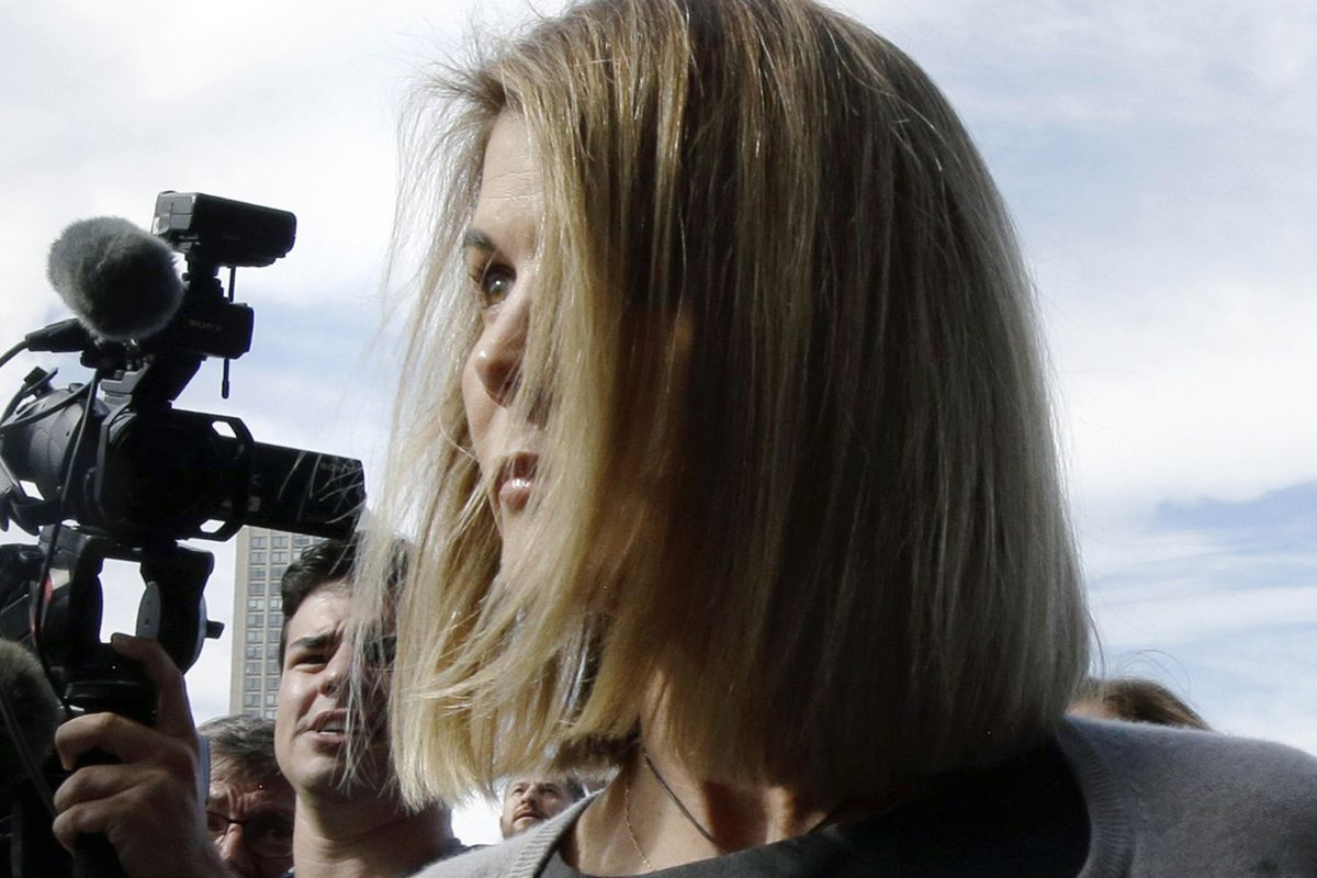 Lori Loughlin departs federal court Tuesday, Aug. 27, 2019, in Boston, after a hearing in a nationwide college admissions baribery scandal.