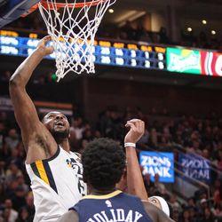 Utah Jazz forward Derrick Favors (15) shoots over New Orleans Pelicans forward Anthony Davis (23) and guard Jrue Holiday (11) as Utah hosts New Orleans at Vivint Arena in Salt Lake on Friday, Dec. 1, 2017.