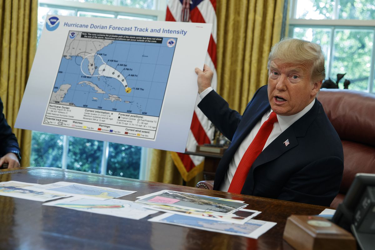 In this Wednesday, Sept. 4, 2019, file photo, President Donald Trump talks with reporters after receiving a briefing on Hurricane Dorian in the Oval Office of the White House, in Washington.