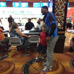 Broncos TE Julius Thomas poses with a fan.